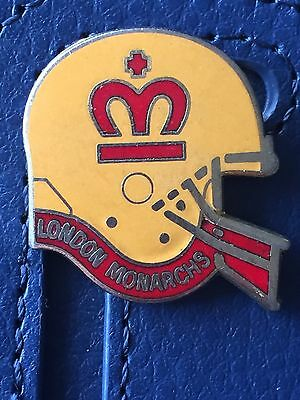 Vintage London Monarchs helmet style metal badge (amber)