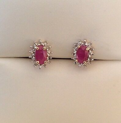 GORGEOUS DIAMOND AND RUBY EARRINGS SET IN 9 ct GOLD