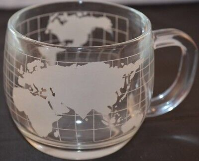ETCHED CLEAR GLASS NESTLE WORLD GLOBE CUP . (33 Available)