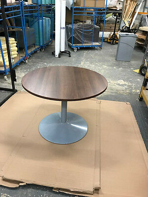 1000mm round meeting table with a Walnut top and grey trumpet base
