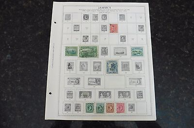 F76 Lot of Jamaica stamps 1860-1965 hinged on 4 Minkus Album Pages