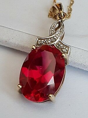 solid 9ct gold 5ct Ruby & diamond set pendant with chain