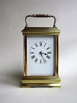 A handsome fairly large cannellee cased striking carriage clock. Circa 1900.