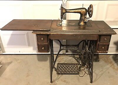 Singer Sewing Machine/Wooden Table With Wrought Iron Legs On Wheels
