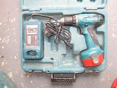 makita 14.4v drill, charger & case (suspect battery)