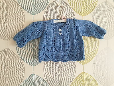 beautiful  hand knit baby  cardigan with duck shaped buttons