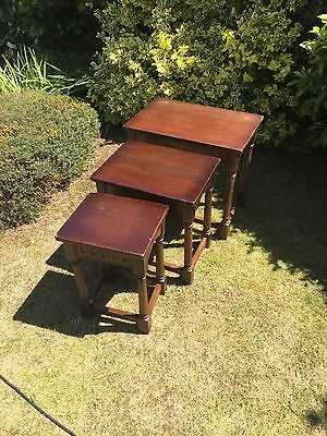 nest of three solid wood tables
