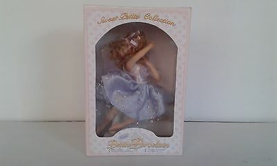 17cm Porcelain Doll with stand. New.