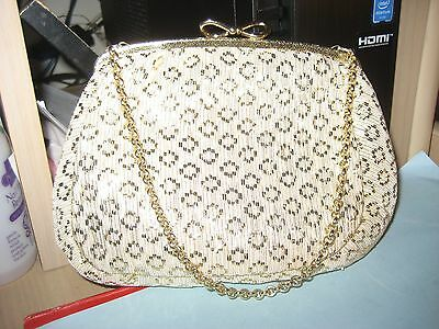 Vintage look gold and cream evening purse with goldtone chain
