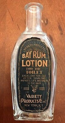 1900s BAY RUM LOTION BOTTLE FOR THE TOILET WITH DECORATED SUNKEN PANELS