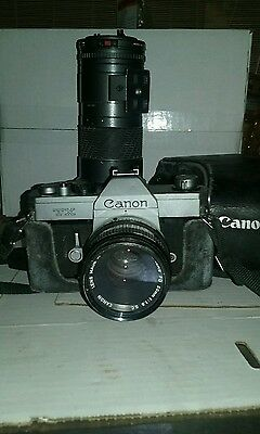 vintage canon TX camera with case and extra lens