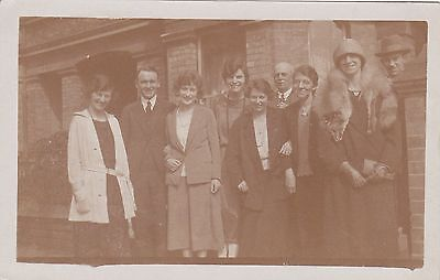Photograph postcard showing a group of unknown people.