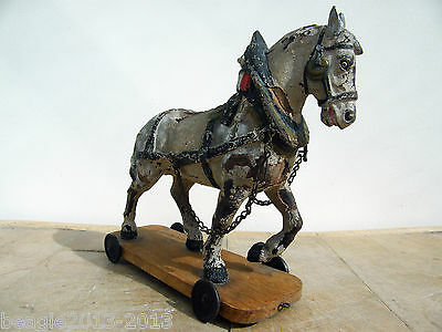 A RARE CARVED ANTIQUE 1800s TOY PULL ALONG HORSE TOY