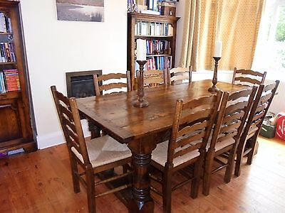 Oak refectory style table and 8 ladderback chairs