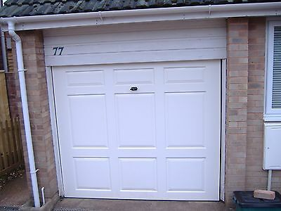 White single up and over garage door used but in good condition.