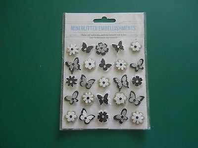 1 Brand New Pack Of 25 Mini Glitter Embellishments In  Black /butterfly/flower.