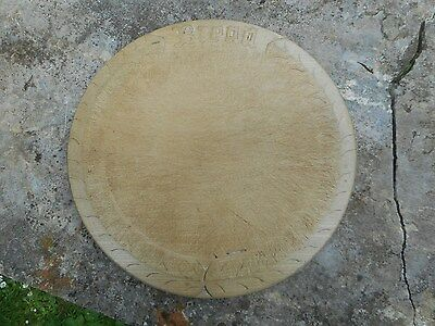 Old  carved wooden bread board,,30cms across. Kitchenalia.