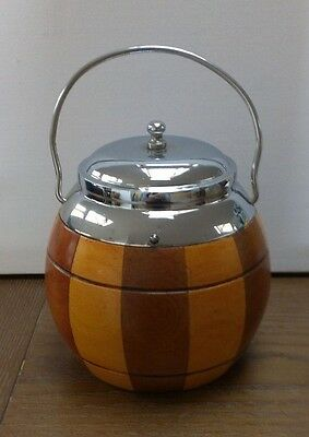 round wooden tea caddy with metal lid