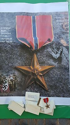 6 + 5   bronze stars -1944 in original boxes  bronze stars  4th of July special