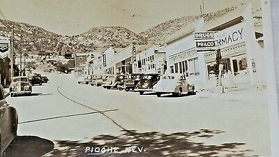 postcard rppc Pioche, NV. cars signs