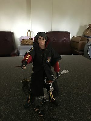Harry Potter figure with broomstick and Quidditch Stand