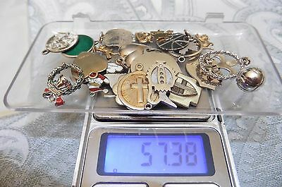 26 Sterling Silver Charms. Tested