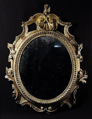 Antique 18th century distressed carved giltwood mirror