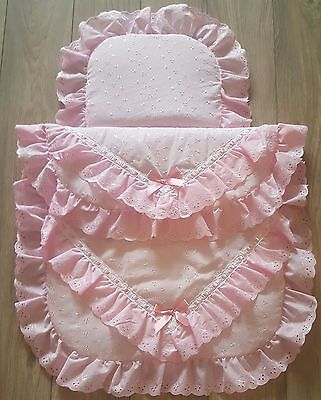 Beautiful pram set quilt and pillow in pink with bows.