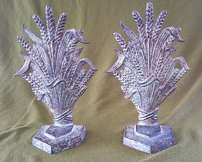 A Pair of Cast Metal Patinated Book Ends in the Georgian Style