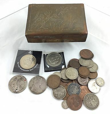 Selection Of Various Coins In Tin