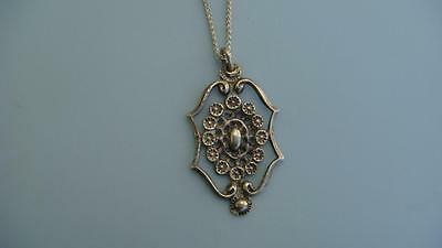 silver pendant on a silver chain