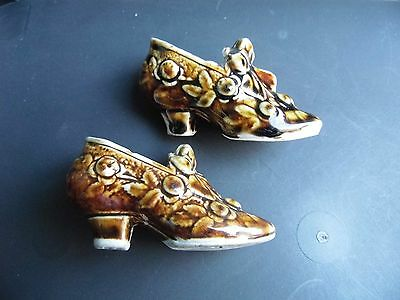 pair of vintage china shoe ornaments in brown
