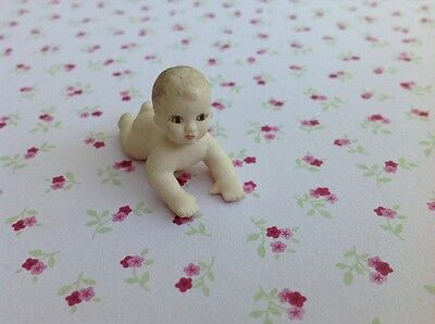 Dolls house miniature ceramic baby doll
