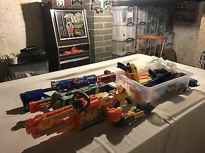 Nerf Guns. 8 Nerf Guns And Bullets Included.