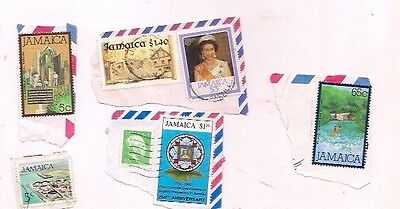 7 JAMAICA stamps on paper.