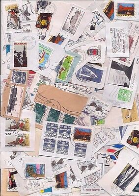 93 DENMARK stamps on paper.