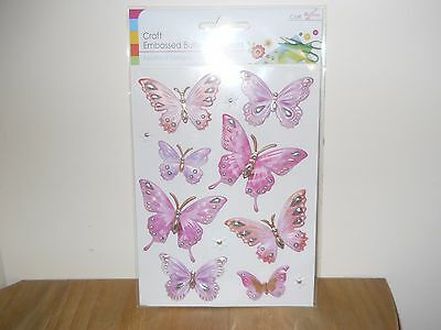 1 Brand New Pack Of 8 Butterfly Embellishments In Pink.