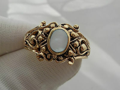 Vintage  Gold colour  ring. with  mother of pearl stone size T approx.