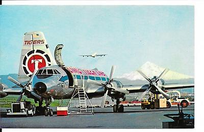 Airline issue postcard-Flying Tiger Line CL44 aircraft