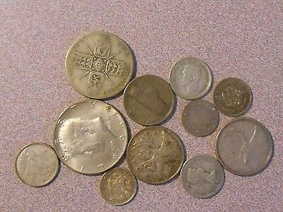 49.7 grams of silver coins from all over the world