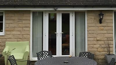 White upvc French patio doors with side panels