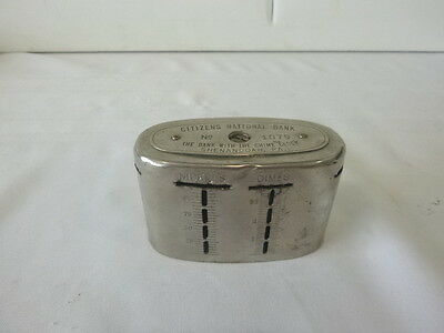 The Citizens National Bank  Vintage chrome oval promotional coin bank with Key