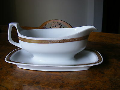 ANTIQUE QUALITY GRAVY BOAT WITH ATTACHED TRAY,GILDED DECORATION, 10 X 23cm.