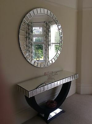 large mirror and mirrored side table