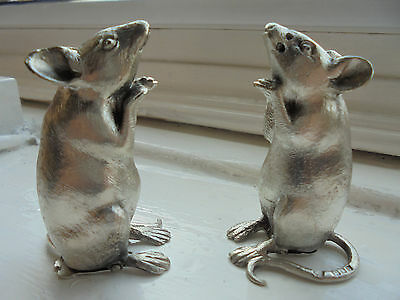 sterling silver salt and pepper shakers in the form of mice.