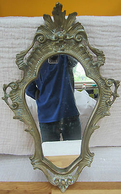 French antique mirror in cast brass frame.