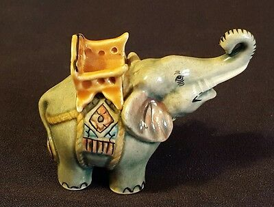Miniature Elephant Figurine with carrying basket seat on back collectible