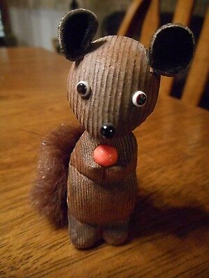 Vintage wooden squirrel holding acorn made in Japan