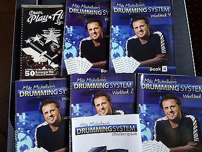 Drumming tuition system comprising DVDs, Cds & Workbooks