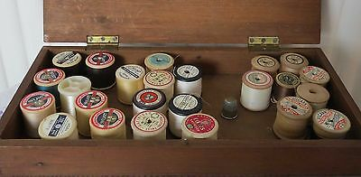 Wooden box of Old sewing thread reels